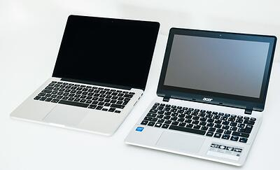 A MacBook and a Windows computer next to each other for comparison | Varay Managed IT, San Antonio & El Paso