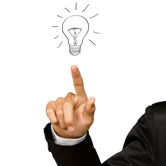 Business hand pointing at an idea light bulb to signify the items you need to know before setting up a successful work-from-home environment