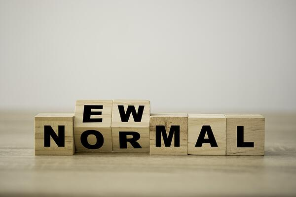 """Wood blocks spelling out """"new normal."""""""