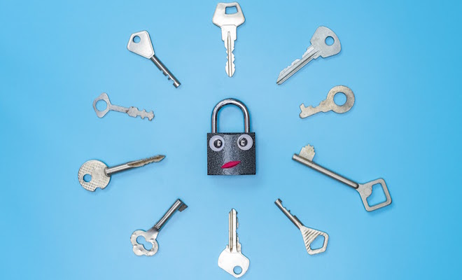 Key lock with two googly eyes and a slight frown surrounded by a circle of different keys on a blue background.